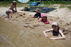 Kids buried at the Sunshine coast river beach